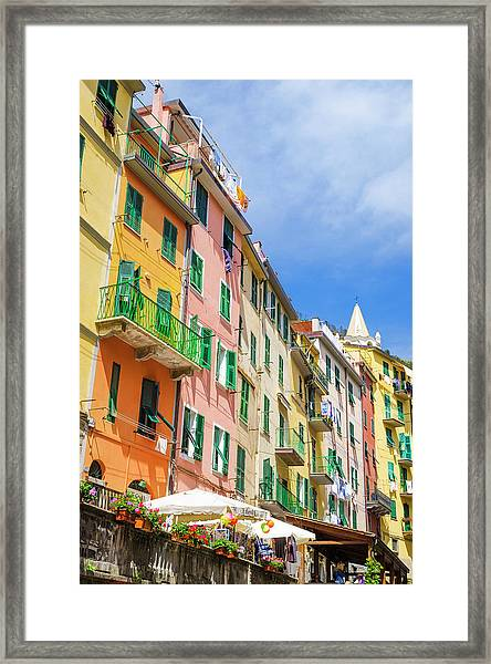 Narrow Street And Colorful Houses Framed Print by Russ Bishop