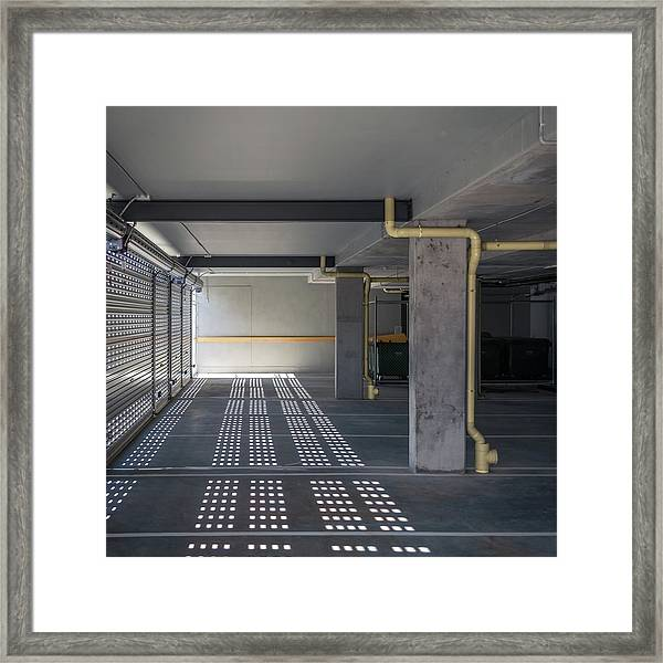 New Grey Parking Interior Framed Print by John Abbate
