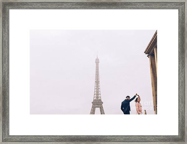 Newly-wed Couple On Their Honeymoon In Paris, Loving Having A Date Near The Eiffel Tower Framed Print