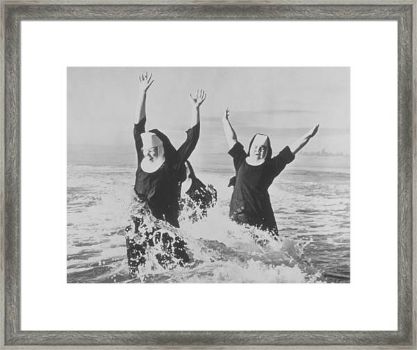 Nuns In The Surf Framed Print