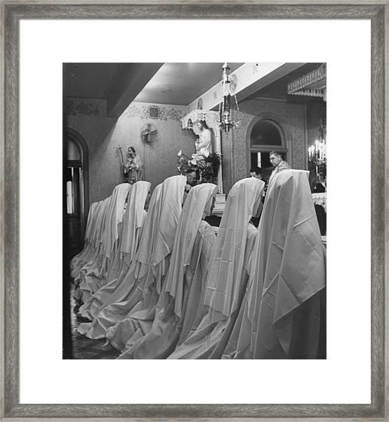 Nuns Of The Carmelite Order Praying To T Framed Print