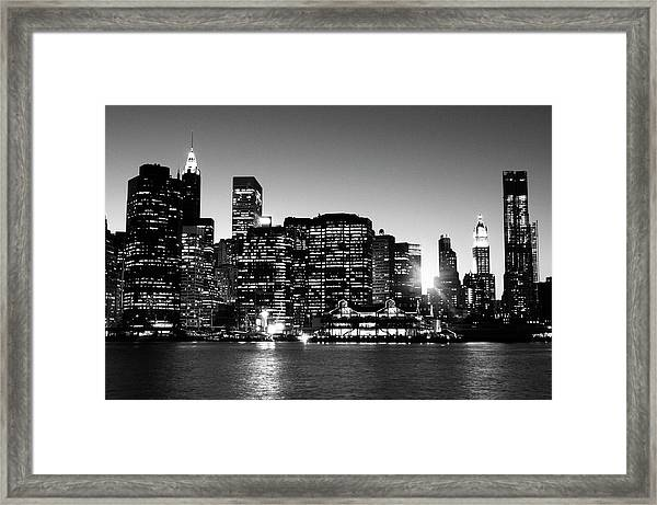 Nyc Skyline At Sunset Framed Print by Lisa-blue