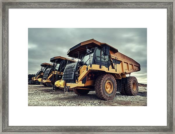 Off-highway Dump Trucks Framed Print