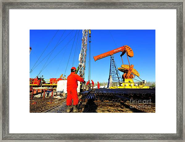 Oil Field Oil Workers At Work Framed Print