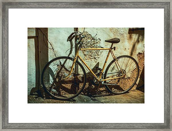 Old Bike Against And Old Wall Framed Print