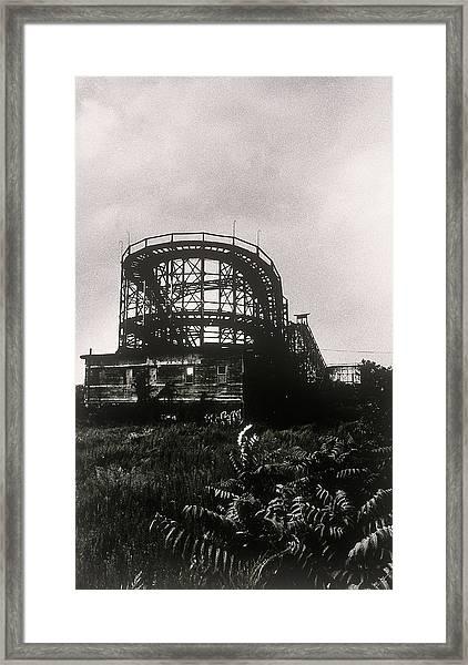 Old Roller Coaster Against Cloudy Sky Framed Print