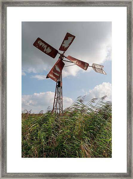 Framed Print featuring the photograph Old Rusty Windmill. by Anjo Ten Kate