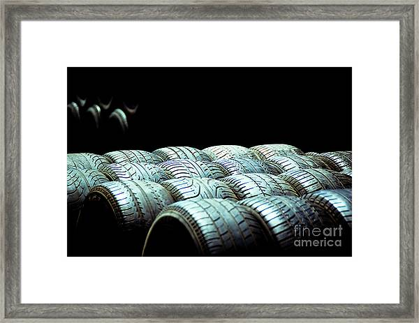 Old Tires And Racing Wheels Stacked In The Sun Framed Print
