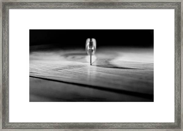 On A Knife Edge Framed Print