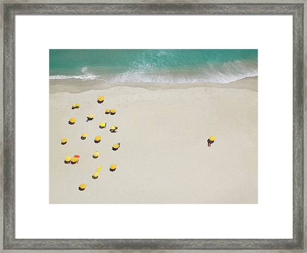 One Person Isolated From Group On Beach Framed Print