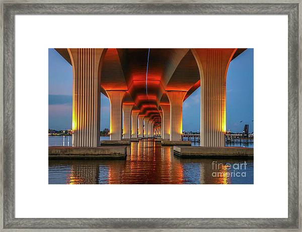Framed Print featuring the photograph Orange Light Bridge Reflection by Tom Claud