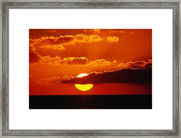 Orange Sunset With Dark Clouds Over Framed Print
