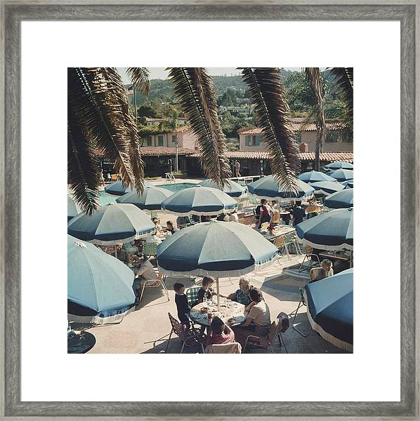 Outdoor Dining Framed Print by Slim Aarons