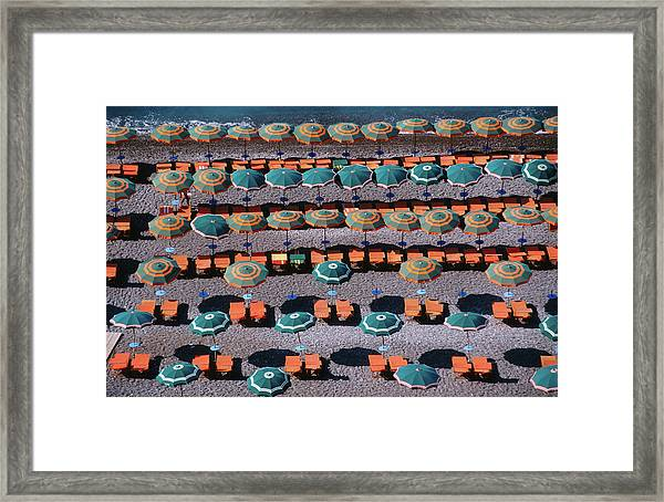 Overhead Of Umbrellas, Deck Chairs On Framed Print by Dallas Stribley