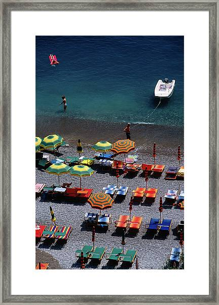 Overhead Of Unmbrellas, Deck Chairs At Framed Print by Dallas Stribley