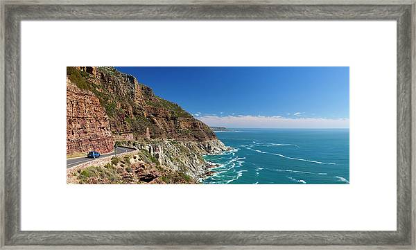 Panorama View Of A Car Driving Along Framed Print