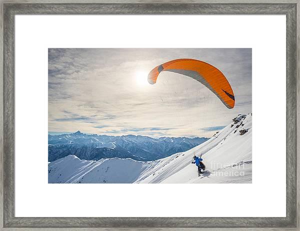 Paraglider Running On Snowy Slope For Framed Print
