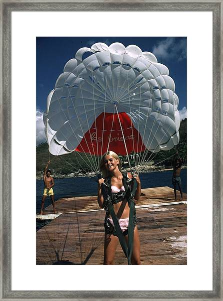 Paraglider Framed Print by Slim Aarons