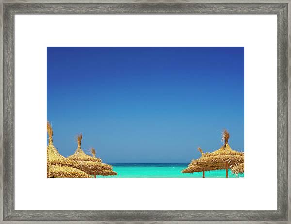 Parasols And Beach, Rethymno, Greece Framed Print