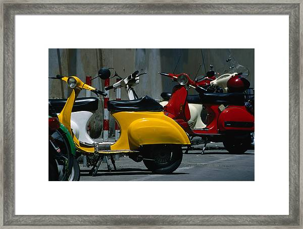 Parked Scooters Framed Print by Martin Moos
