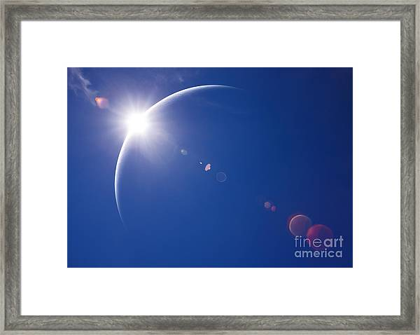 Partial Solar Eclipse With Blue Sky And Framed Print