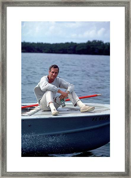 Paul Newman On Boat Framed Print by Mark Kauffman