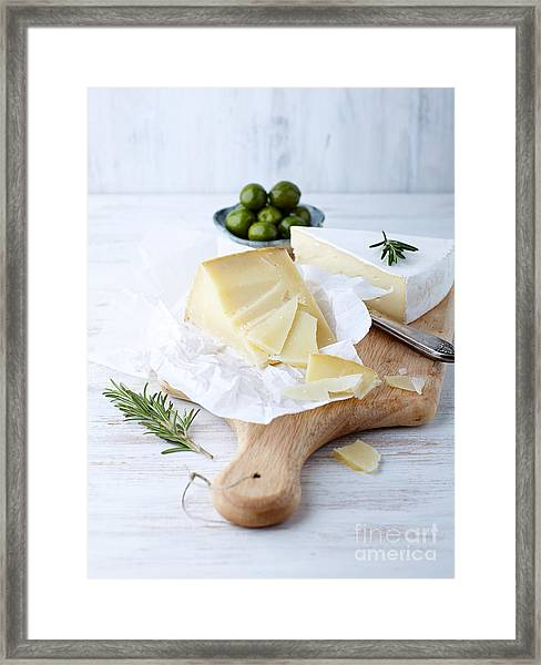 Pecorino And Brie Cheese On A Kitchen Framed Print