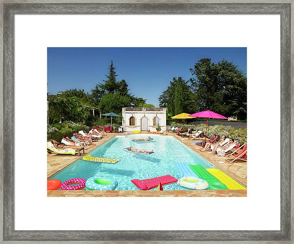 People Enjoying Summer Around The Pool Framed Print by Ghislain & Marie David De Lossy
