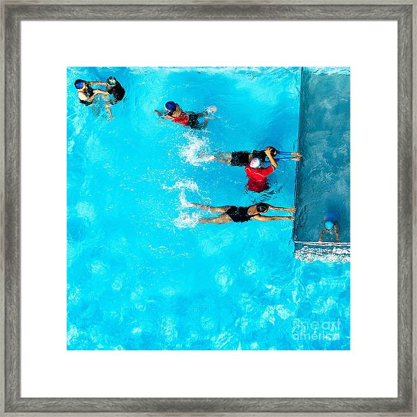 People Exercising In A Swimming Pool Framed Print
