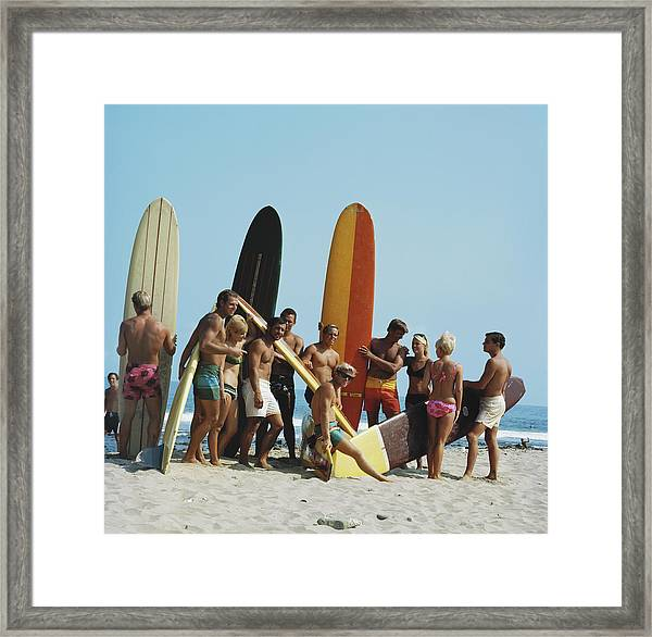 People On Beach With Surf Board Framed Print