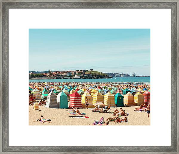 People Relaxing On Gijón Beach Framed Print