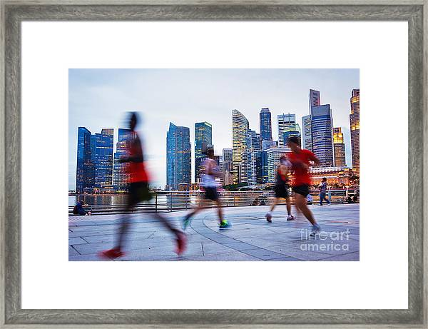 People Runing In The Evening In Framed Print