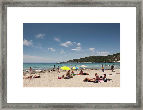 People Sunbathing At Platje De Ses Framed Print