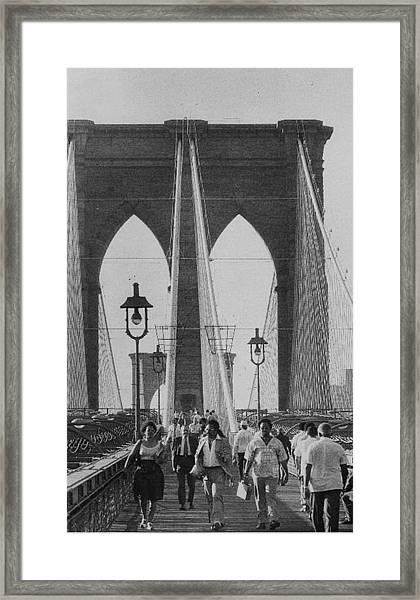 People Walk Across The Brooklyn Bridge Framed Print