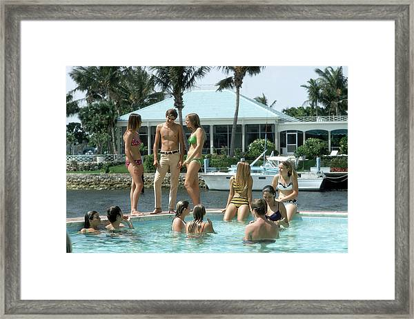 Phil Richards Pool Framed Print by Slim Aarons