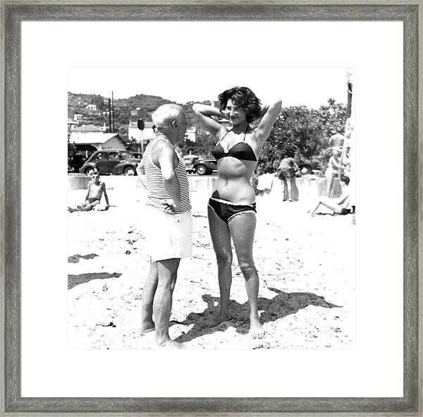 Picasso And Bikini-clad Woman On The Framed Print by Hulton Archive