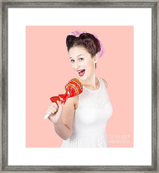 Pin-up Girl Singing Into Large Lollypop Microphone Framed Print