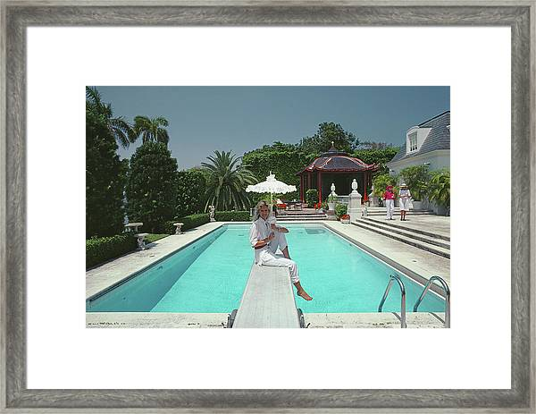Pool And Parasol Framed Print