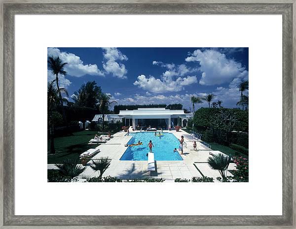 Pool In Palm Beach Framed Print by Slim Aarons