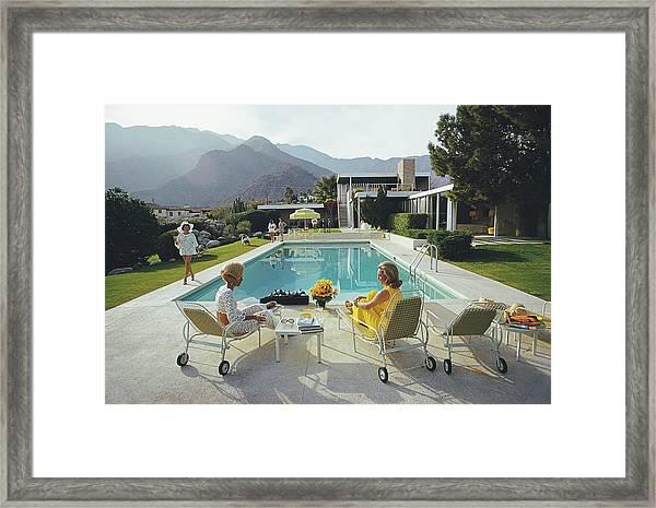 Poolside Gossip Framed Print