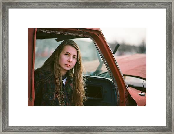 Portrait In A Truck Framed Print