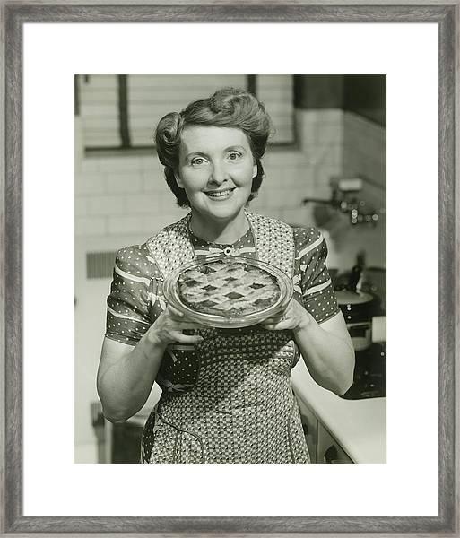 Portrait Of Mature Woman Holding Pie Framed Print