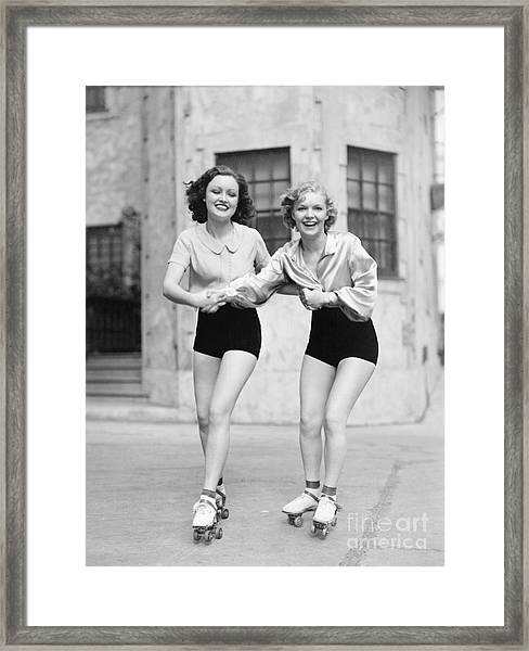 Portrait Of Two Young Women With Roller Framed Print