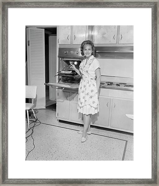 Portrait Of Woman Cooking In Kitchen Framed Print