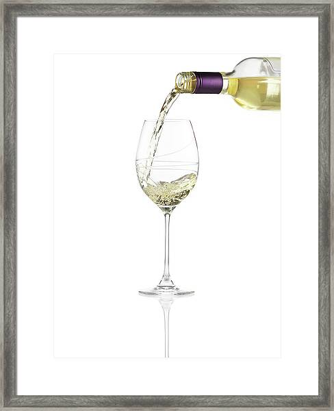 Pouring A Glass Of White Wine Framed Print by Steven Krug