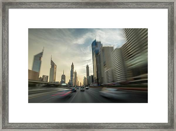 Pov Of A Car  Driving Through Dubai Framed Print