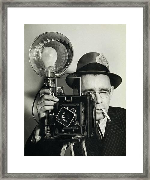 Press Photographer Holding Camera Framed Print