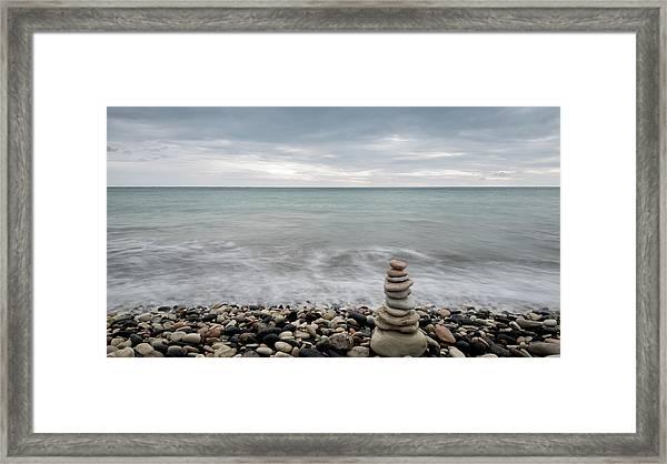 Pyramid Of Balancing Stones , In The Wavy Ocean Framed Print