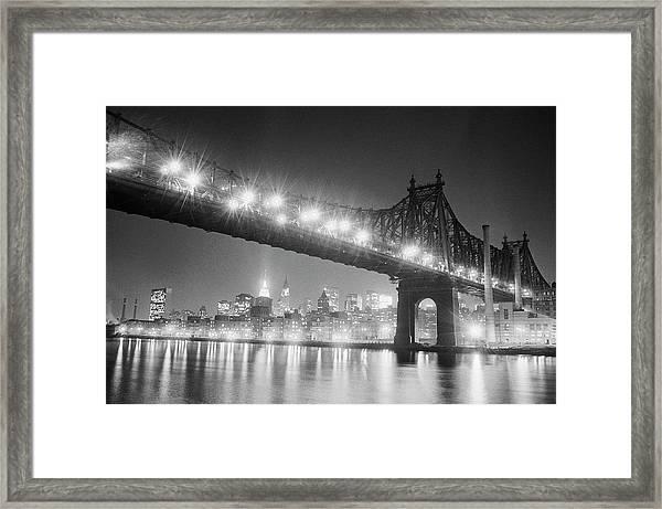Queensboro Bridge And Manhattan At Night Framed Print