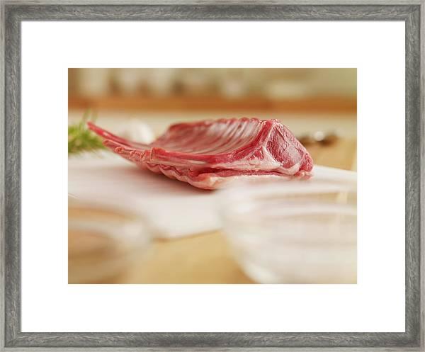 Raw Rack Of Lamb On Cutting Board Framed Print